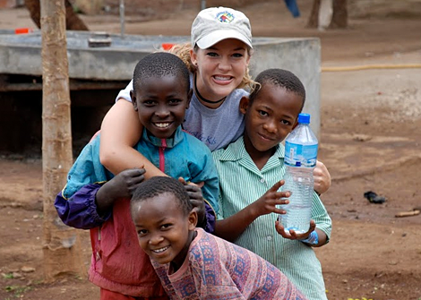 Trekker with orphans in Tanzania